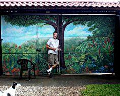Scott K Wimer in front of mural on steele garage doors in Ciudad Colon, Costa Rica