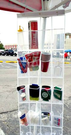 Tailgate Idea ~ Use a clear hanging shoe organizer for tailgating... Hang it on the tent canopy rails and roll it up after the game. Easy way to see where things are and what needs refilling - and frees up the table for food! Great for Camping too!