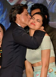 Shah Rukh Khan kissing Deepika Padukone at launch of Sharabi song from 'Happy New Year'.
