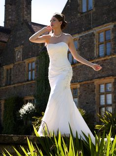 Romantica: Canterbury - A stunning gown with a slight fishtail skirt and a graceful lace overlay.