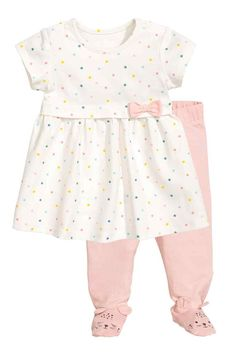 c4d6b77f0b54 Set with a dress and leggings in soft organic cotton jersey. Short-sleeved  dress with press-studs on the shoulders