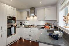 The Gosford kitchen shown with stylish grey sparkle quartz worktops.