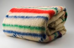 Cobertores de Papa.blankets made in Portugal. 100%wool, with traditional mtehods.made in Maçainhas village,near Guarda with the thick,long greasy wool of local sheeps.So worm in winter.  A Vida Portuguesa