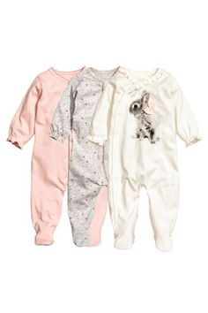 3-pack all-in-one pyjamas: CONSCIOUS. All-in-one pyjamas in soft, organic cotton jersey with press-studs at the front that continue down one leg, full feet and long sleeves with frills at the cuffs.