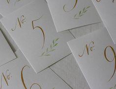 Bordnummer i gull, hvitt & grønt til et bryllup i Kroatia denne uken // Table numbers, gold, white & green for a wedding in Croatia this past week ✨ #springcalligraphy