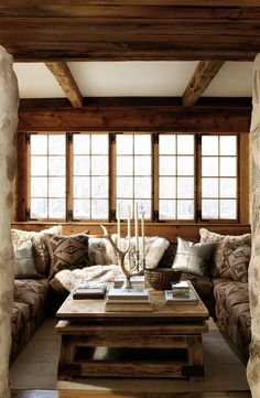 Western prints and alpine-inspired decor, this Ralph Lauren Home living room exudes winter rustic glamour in a warm ski chalet.