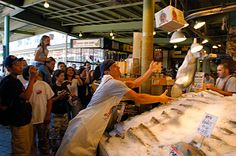 The famous Pike Place Market fish throwers. They're very funny. Also another thing that doesn't get old.