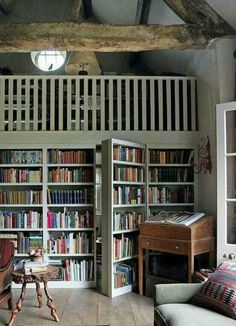 A rustic green bookshelf with a hidden doorway