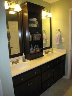 Revamp that large bathroom mirror... insert shelving and frame remaining mirror to give impression of two!