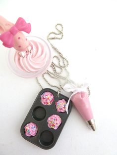 "The Bakers Necklace "" Who Ate My Cupcakes"" Miniature Cupcake Muffin Pan with fake cupcake frosting and and pink Pastry Bag charm. Via Etsy! I need this like I need oxygen!"