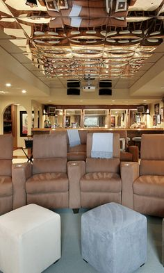 Glitzy home theater with large individual chairs each with personal ottoman