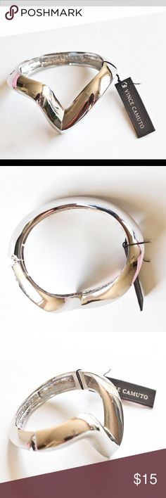 """Vince CAMUTO💋Signature Hinged Bangle Silvertone 💋Vince CAMUTO, Signature V hinged bangle bracelet in Silver-tone metal, 2.25"""" oval, width varies from 0.5"""" to about 1"""" at center V. Stylish accent for any wardrobe.  Attain Priced! Vince Camuto Jewelry Bracelets"""
