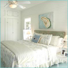 ♥ the chippy, old door turned onto its side for the headboard & that lat siding wall