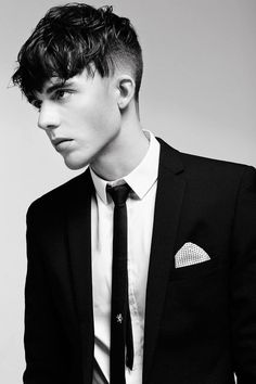 The angular fringe was an emerging trend among male fashion models in 2014, and it was so widely popular, we are certain it will become a widely popular trend among all men in 2015. This look is achieved with tapered sides, but keeps the top layer long and cut at angle. It looks great on all face shapes, but is best suited for men with a round face. #menshair