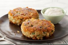 Instead of frying it and getting popped by oil (OUCH), we put the salmon patties into muffin tins and bake them. We also substitute the stuffing mix for old-fashioned Quaker oats.