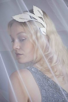 The Season Hats - White leather leaf hairband with pearl detail.Perfect for brides, can be styled with a veil.