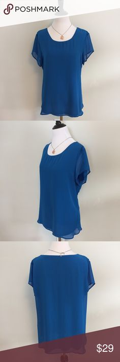 ANN TAYLOR Blouse You will shine wearing this blue flowy blouse from Ann Taylor. Size large. 100% polyester and machine washable. Has inner lining. Good used condition. Ann Taylor Tops Blouses