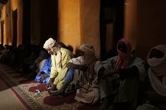 Feb. 1, 2013. Malians attend Friday prayers at the Djinguereber mosque in the center of Timbuktu, Mali.