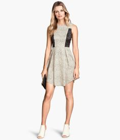 H&M. Sleeveless dress in woven fabric with a fitted bodice, seam at waist, concealed back zip, and flared, pleated skirt.