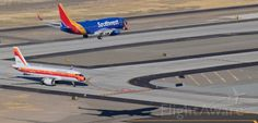 Although the visual angle of this shot might make it seem that Southwest's N7835A is lined up to land on Bravo taxiway, the shadow on the ground gives the true picture .... the SWA fleetbird, arriving from KLAS at 10 AM, is correctly lined up to land on KRNO's 34L as American's N742PS, dressed in the colorful PSA heritage livery, waits at the 34L HOLD line.