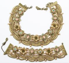 Lot 556: Michal Negrin Jewelry Suite; A matching set of choker necklace and bracelet in the original boxes; decorated with braids, crystals, faux cameos and pearls