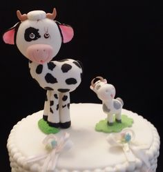 Cow Mommy and Baby Cake topper All Handmade from Cold Porcelain Listing is for one Mommy Cow Approx .5'' Tall and one Baby Cow Approx 2.2'' Tall Perfect for Cake Decoarations, Center Pieces, Baby Favo