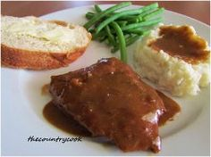Slow Cooker Cube Steak with Gravy - This all-day slow cooker beef recipe is a comforting dish for a weeknight meal.