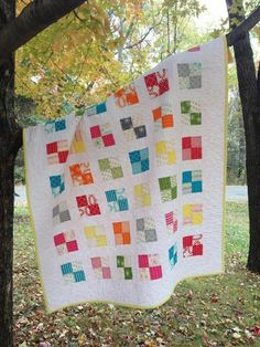 Turn eight coordinating Fat Eighths into this playful square quilt! With a contrasting background fabric, the small squares will stand out. #MidnightQuiltShow