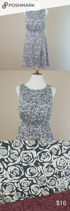 Charming Charlie  Black &White Rose Print Dress Black & white rose print scoopneck dress from Charming Charlie. Elastic at waist w/crossover skirt. Lined.  Laying flat chest measures 28'. Waist 14'. Total length of dress is 37'. Shell and lining 100% Polyester. Charming Charlie Dresses