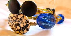 Transparent Blue stone looks like a piece of stained glass art. This popular gem is dazzling on a gold bangle.