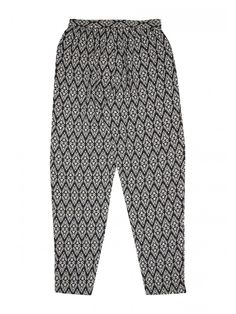 Give her collection of casual wardrobe staples a touch of patterned flair with these older girls' printed viscose trousers. Featuring an elasticated drawstri...