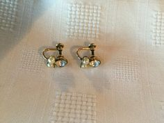 Pearl and Rhinestone screw back earrings. Marked Amco 1/20 12 kt Gold filled.