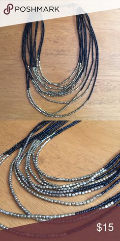 """Black & Gold Beaded Statement Necklace Gorgeous black and gold beaded necklace. 10"""" long. No trades but offers are always       welcome ✅                                                                   Thanks for looking!  Jewelry Necklaces"""