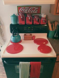 I love the little red canisters and the teal tea kettle