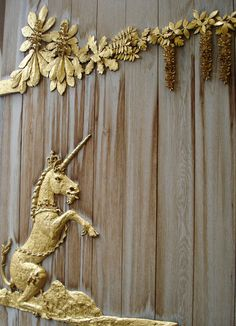 Golden Unicorn door detail,   The Palace of Holyroodhouse, Edinburgh, Scotland. December 2007.
