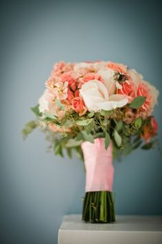 A lovely mix of pink and peach flowers in this wedding bouquet   Kate Connolly Photography