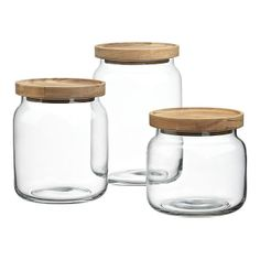 Glass jars with wooden lids. Chic kitchen product love.