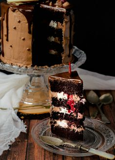 This chocolate cherry cake is a showstopper with its duo buttercream filling and cherry surprise. Covered in buttercream, it looks and tastes great! Chocolate Ganache Glaze, Chocolate Cherry Cake, White Chocolate Buttercream, Buttercream Filling, Chocolate Desserts, Decadent Chocolate, Fudge Cake, Brownie Cake, Custard Cake