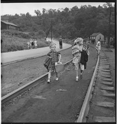 Coming home from school. Mining town. Osage, Scotts Run, West Virginia. Marion Post Wolcott. September 1938. LC-USF34-050352-E