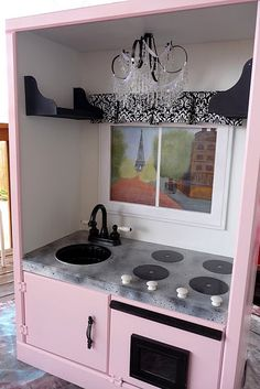 play kitchen made from old entertainment center