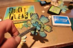 Creating paper flowers with Tim Holtz Sizzix dies - Mixed media studio sign by Marjie Kemper with Ranger distress inks, stamps, and stencils