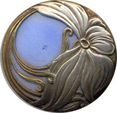 "Glass button — you know that ""a swirling floral design of silvered brass"" is the sweetest description ever."
