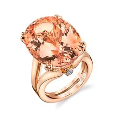 R0645D by Parade Design. An exquisite 24.62 carat oval Morganite sits in a split band of glowing high polished 18K rose gold, in this contemporary stunner from the Parade in Color collection.