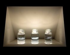 Charlotte Charbonnel, ADN, aperçu de nuage, 2005-2013; Coll. de l'artiste. Photo : C. Clier  © C. Charbonnel. Verre, eau distillée, alcool, lait  – dimensions variables