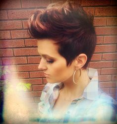 Short, Pixie, Fohawk. Burgundy-Brown with highlights on tips. Sides/back buzzed. Heidi Mickelson does my hair!!