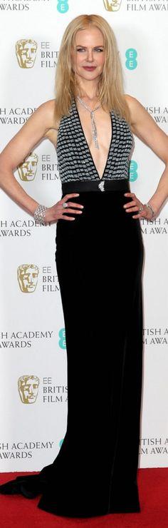 Nicole Kidman in Dress and shoes – Armani Prive  Jewelry – Harry Winston  Watch – Omega