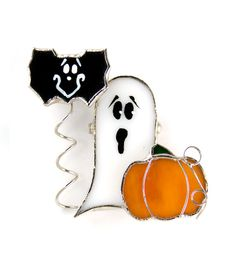 Handmade stained glass Halloween pin and pendant.