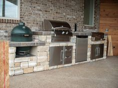 Gas grill, smoker, charcoal grill, this one does it all and looks good too. Let Best in Backyards help you create the ultimate backyard experience with a custom kitchen island. Select all of the components that you would like to feature from our wide arr Outdoor Kitchen Patio, Outdoor Kitchen Countertops, Bbq Kitchen, Outdoor Kitchen Design, Outdoor Living, Kitchen Ideas, Kitchen Layout, Kitchen Designs, Kitchen Appliances