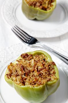Turkey Jambalaya Stuffed Bell Peppers | Take advantage of fresh produce this summer and make Jambalaya Stuffed Bell Peppers, a delicious dinner of rice, the holy trinity (of onion, celery and bell pepper) and ground turkey, baked inside a bell pepper!