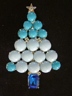 DeLillo brooch covered in blue beads to create a stylized modern design Christmas Tree